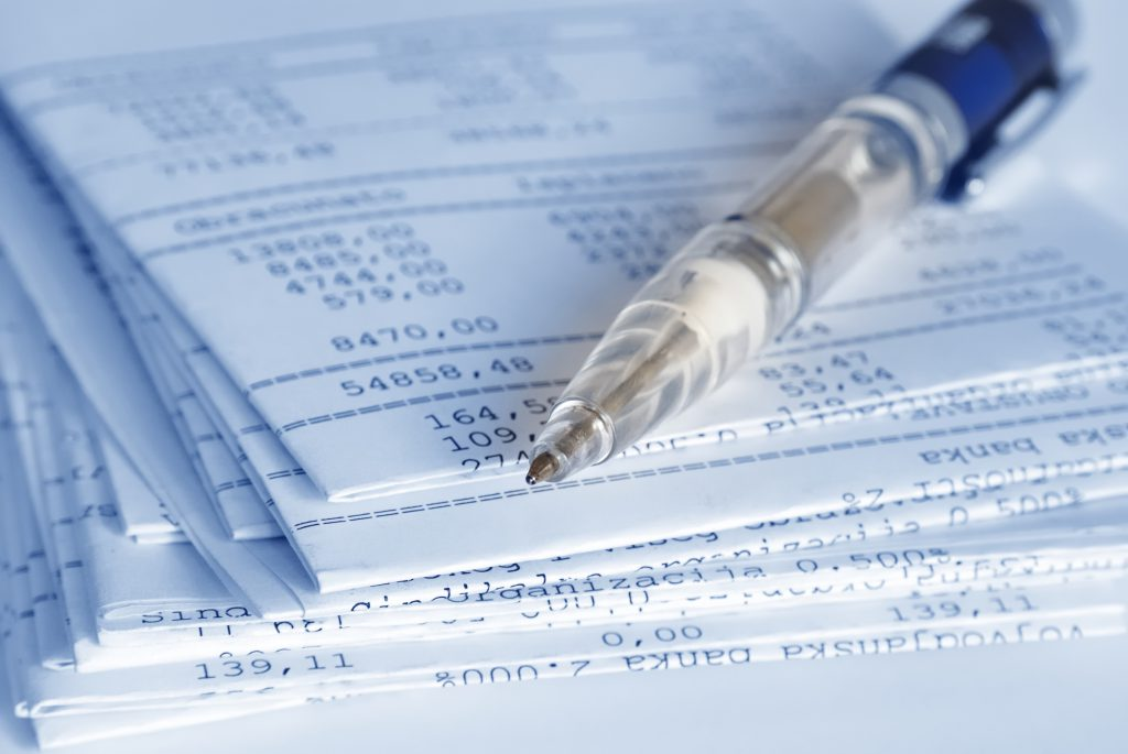 Banking reports on a folded sheets and pen Stock Photo